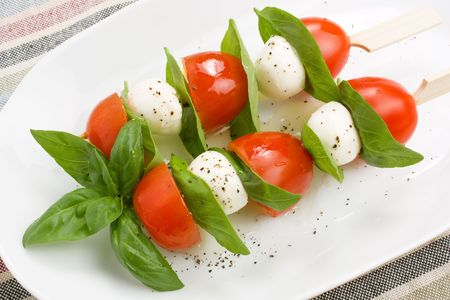 Mozzarella, basil and cherry tomatoes kebab