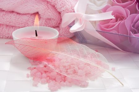 Aroma candle, bath salt and soap flowers of roses set for aromatherapy
