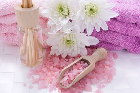 Bath salt, aromatic oil and chrysanthemums for aromatherapy Stock Photo