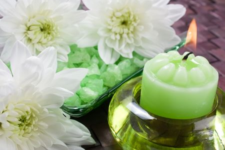Aroma candle, bath salt and chrysanthemums for aromatherapy