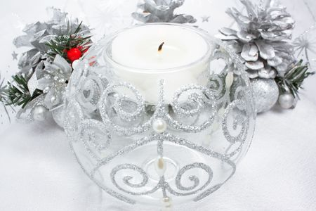 Christmas candle and silver spruce cones decoration