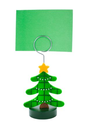 Green note paper in Christmas tree sticker holder on a white background Standard-Bild