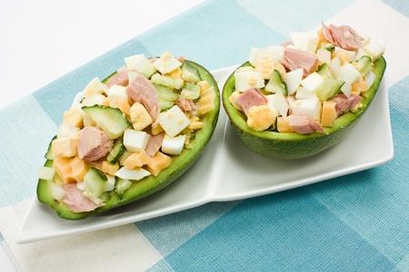 tuna mayo: Avocado stuffed with tuna, cucumbers, eggs and cheese