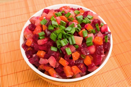 Vinaigrette Russian salad of beetroot, carrot, potato, green leek and olive oil photo