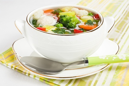 Soup with chicken meatballs and fresh vegetable dietary healthy food