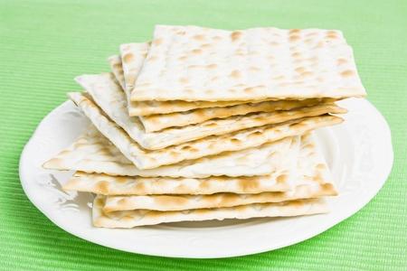 jewish cuisine: Pile of Jewish Matza bread on a plate