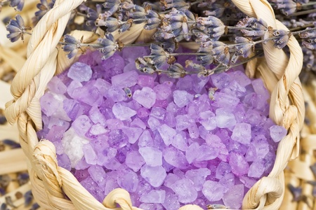 Aromatic bath salt and dry lavender flowers in wicker basket shallow DOF Stock Photo - 12065478