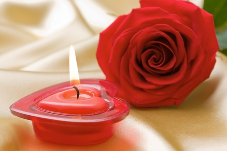 Aromatic candle in form heart and red rose  Stock Photo