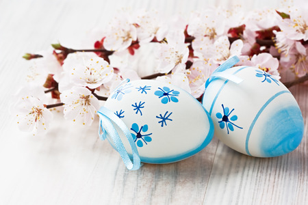 Easter egg decoration with apricot flower on wooden background Stock Photo