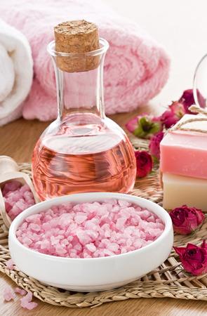 SPA treatment set with sea salt, rose aroma oil and soap bar photo