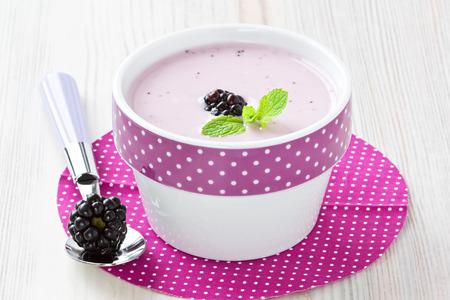 Fresh yogurt with sweet dewberry for healthy breakfast