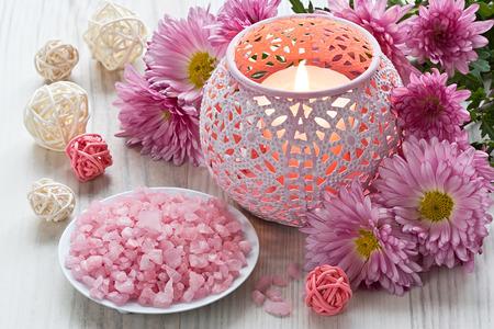 Aromatic sea salt, aroma candle and chrysanthemum flowers