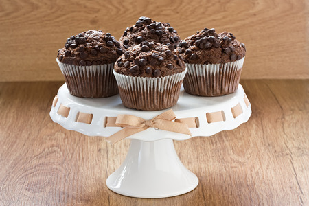 Chocolate chip muffins delicious sweet dessert on wooden background