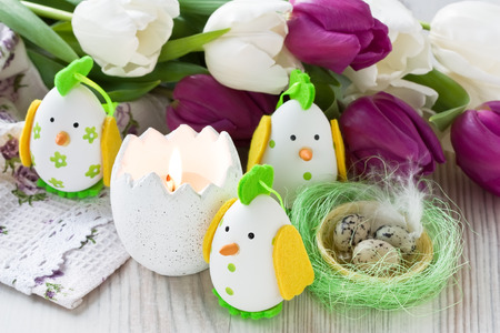 easter candle: Easter chicken egg decoration with candle and tulip flower Stock Photo