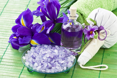 Aromatic sea salt, essential oil, herbal bag for Thai massage and relax Stock Photo