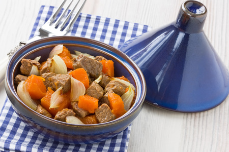 Delicious beef stew with pumpkin and onion in tajine pot Stock Photo