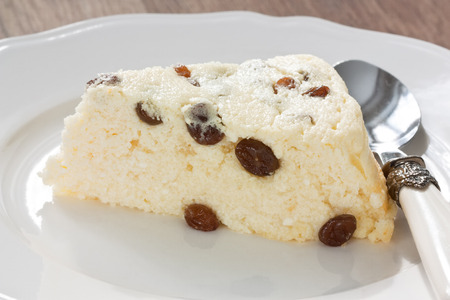 Delicious slice cottage cheese souffle with raisins on white plate