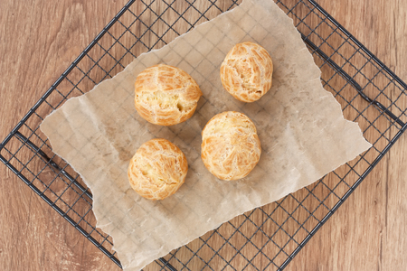 biscuits: Delicious homemade baked eclair row shells cake on metal cooling rack