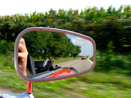 rearview: view in the rearview mirror of a car