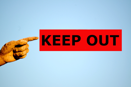 keep out: finger with red rectangular label KEEP OUT Stock Photo