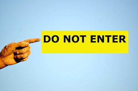 do not enter: finger with rectangular yellow label DO NOT ENTER