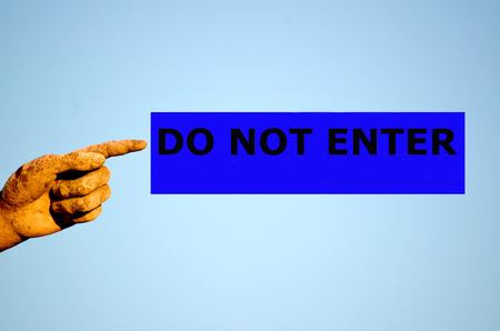 do not enter: finger with rectangular blue label DO NOT ENTER