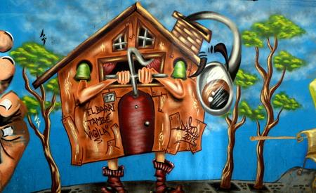 Graffiti urban art or vandalism in Barcelona Stock Photo