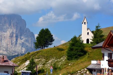 gardena: church to Gardena pass dolomites north italy