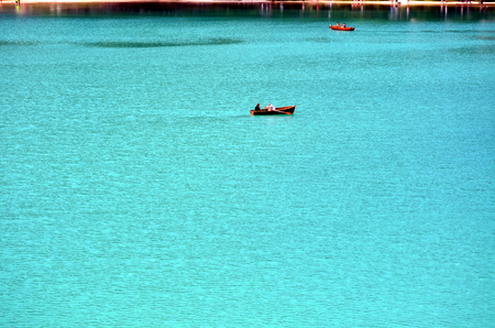 alpine water: Mountain lake in north italy with a boat
