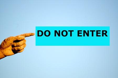 do not enter: finger with rectangular light blue label DO NOT ENTER