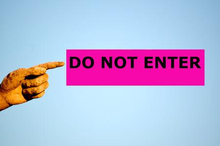 do not enter: finger with rectangular purple label DO NOT ENTER