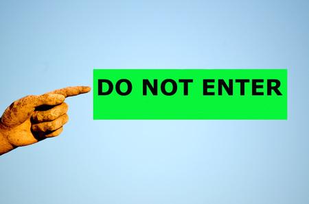 do not enter: finger with rectangular green label DO NOT ENTER