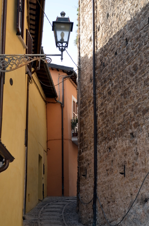 social history: Wonderful street in the small medieval town in sunny day