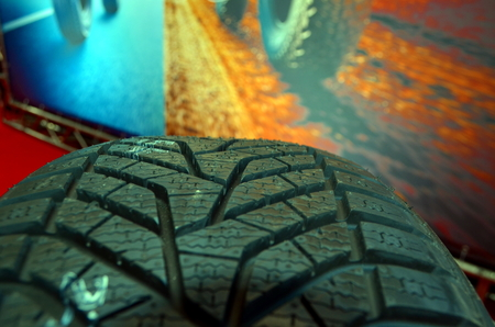 Close up of a high performance tire in auto repair garage or shop for tires