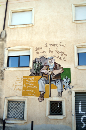 struggles: ORGOSOLO ITALY 4 October 2015: Murals Happy is the people who do not need heroes in Orgosolo Italy Since about 1969 the wall paintings reflect different aspects of Sardinias political struggles