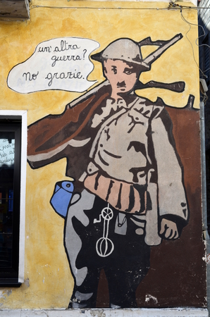 aspects: ORGOSOLO ITALY 4 October 2015: Murals No thanks Another war in Orgosolo Italy Since about 1969 the wall paintings reflect different aspects of Sardinias political struggles and international issues