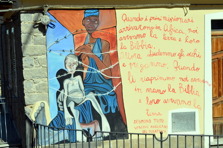 struggles: ORGOSOLO ITALY 4 October 2015 Murals in Orgosolo Italy Since about 1969 the wall paintings reflect different aspects of Sardinias political struggles and international issues