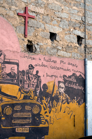 aspects: ORGOSOLO ITALY 4 October 2015 Murals in Orgosolo Italy Since about 1969 the wall paintings reflect different aspects of Sardinias political struggles and international issues
