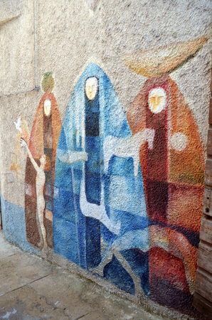 murals: ORGOSOLO ITALY 4 October 2015 Murals in Orgosolo Italy Since about 1969 the wall paintings reflect different aspects of Sardinias political struggles and international issues