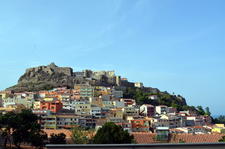 destination scenics: View of Castelsardo fortress and village from the beach Sardinia Italy Editorial