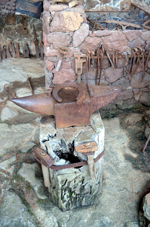 Old blacksmiths anvil with horseshoe