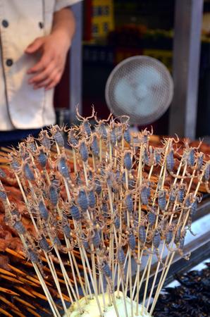 Chinese street food in the Hutongs of Beijing Wangfujing Street roasted scorpions as snacks street food in China Stock Photo