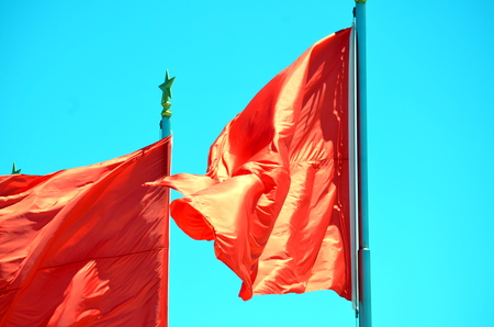 communists: Chinese national flag waving on a clear day