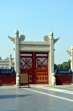 door knob: Old red wooden gate in The Temple of Heaven, Beijing, China. Chinese traditional designs (Qing dynasty style) It Reflects imperial power