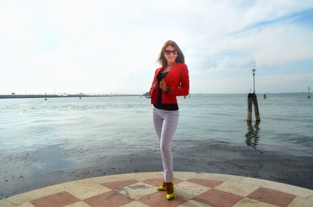 Young girl with red jacket and white trousers Stock Photo