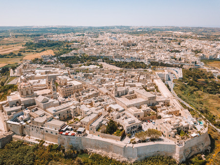 Aerial view of the fortified capital city of Malta, The Silent City, Mdina or L-Imdina, skyline against blue Spring skies with huge walls, cathedral domes and towers. Banque d'images