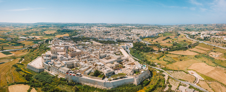 Aerial view of the fortified capital city of Malta, The Silent City, Mdina or L-Imdina, skyline against blue Spring skies with huge walls, cathedral domes and towers. Reklamní fotografie