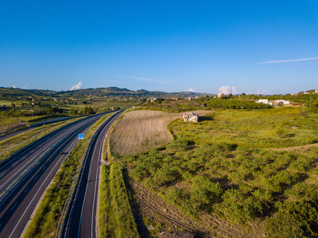 Beautiful aerial view of the highway in Italy with cars passing by. Banco de Imagens