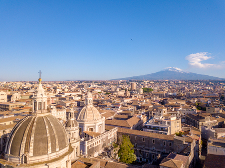 Beautiful aerial view of the Catania city near the main Cathedral and Etna volcano on the background. Amazing old town view from above. Stock Photo