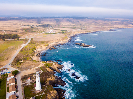 Amazing aerial view of the lighthouse by the pacific ocean near San Francisco and Santa Cruz city